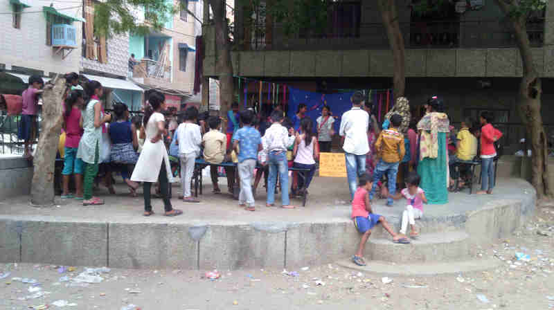 People watching street play – चमेली की पढ़ाई – which highlights the problems in the current education ecosystem.