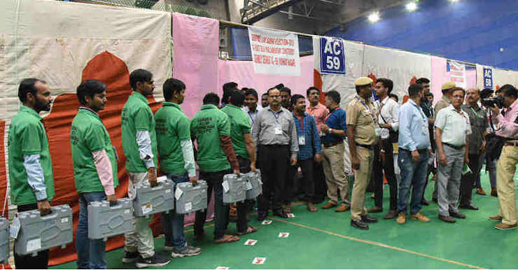 The electoral officials carrying Electronic Voting Machines (EVMs) for counting, at a counting centre of General Election 2019, at CWG Village, Sports Complex, in New Delhi on May 23, 2019. Photo: PIB