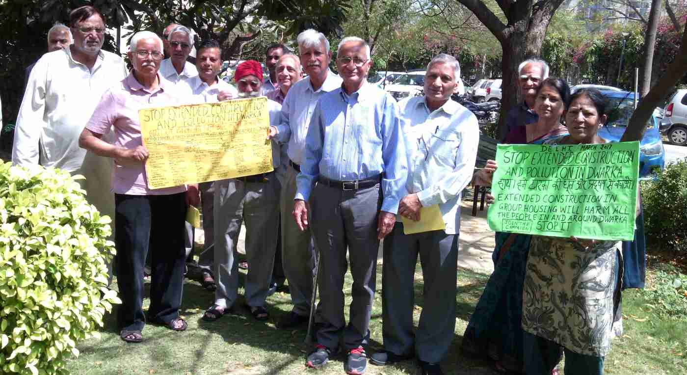 Senior citizens participating in RMN Foundation campaign to stop extended construction and pollution in Delhi.